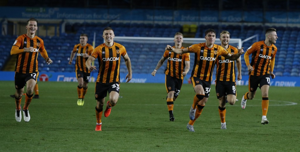 Hull's players run to celebrate after their winning penalty following the penalty shootout, during the English League Cup soccer match between Leeds U...