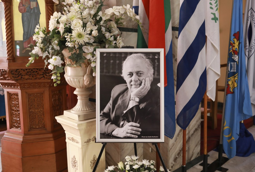 A portrait of George Bizos, stands in front at his official funeral service at the Hellenic Cultural Centre in Johannesburg, South Africa, Thursday, S...
