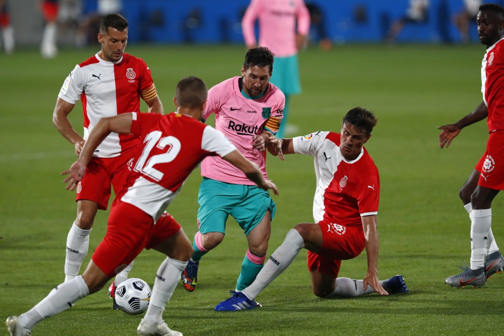 Barcelona's Lionel Messi, center, in action during the pre-season friendly soccer match between Barcelona and Girona at the Johan Cruyff Stadium in Ba...