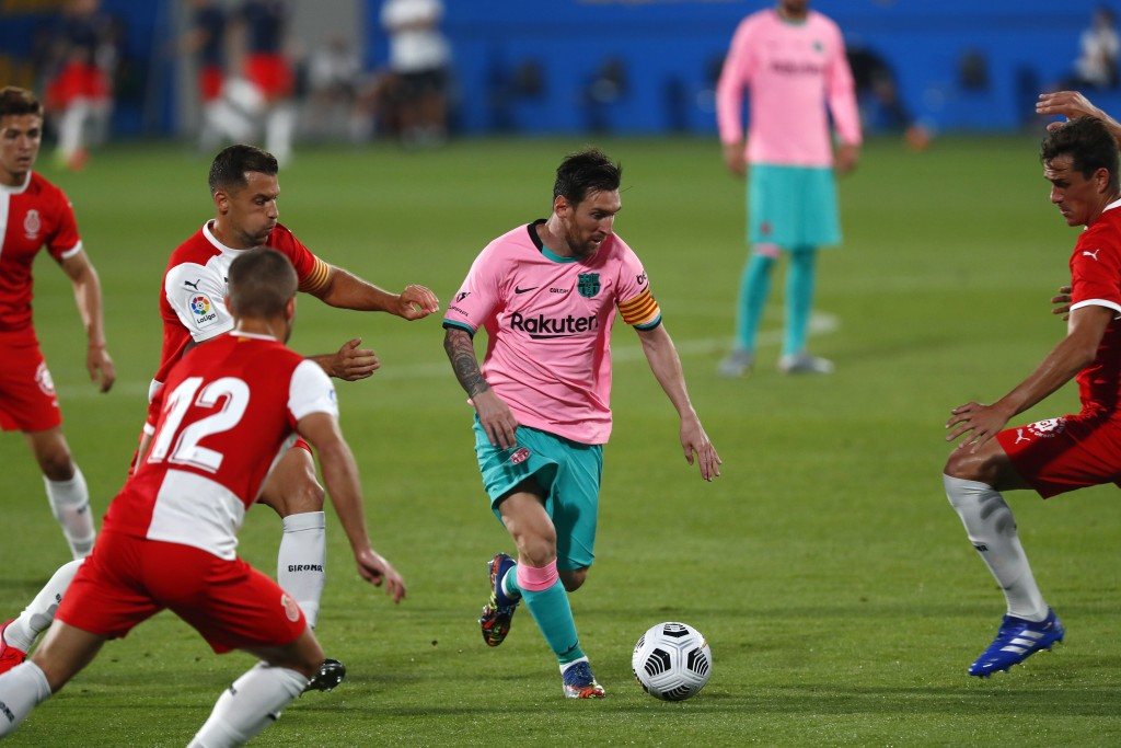 Barcelona's Lionel Messi, centre, in action during the pre-season friendly soccer match between Barcelona and Girona at the Johan Cruyff Stadium in Ba...