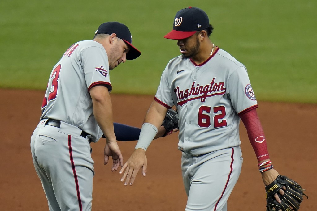 Washington Nationals' Luis Garcia (62) and Asdrubal Cabrera (13) celebrate after the team defeated the Tampa Bay Rays during a baseball game Wednesday...