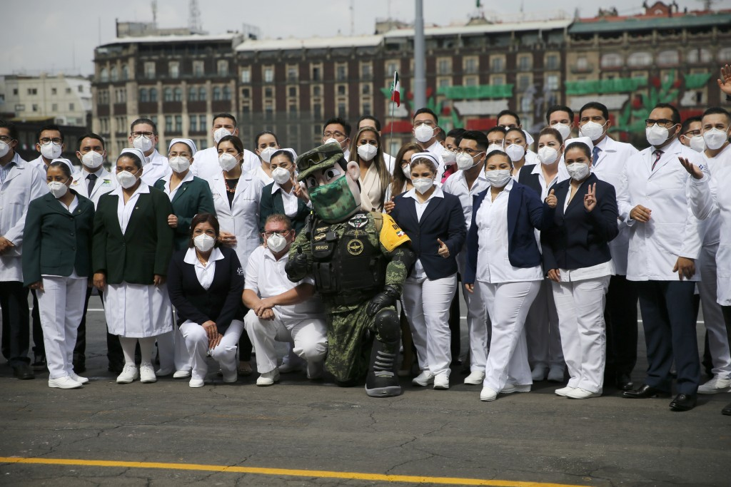Medical workers who tend to COVID-19 patients and who received a medal from the government as recognition for their efforts pose for a photo with an A...