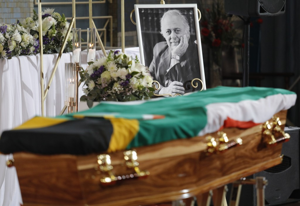 The coffin draped in a South African flag at the official funeral service of George Bizos, portrait background, at the Hellenic Cultural Centre in Joh...