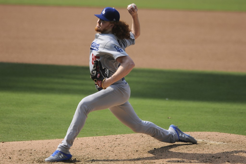 Los Angeles Dodgers' relief pitcher Dustin May delivers a pitch against the San Diego Padres in the fifth inning of a baseball game Wednesday, Sept. 1...