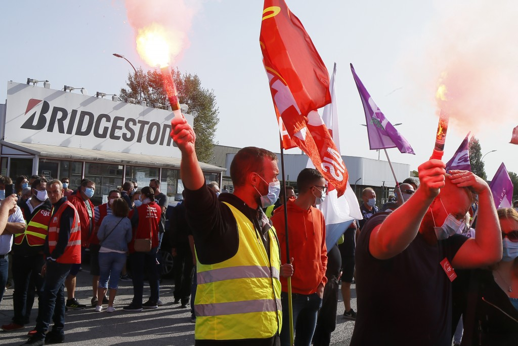 Bridgestone employees gather outside the tire factory of Bethune, northern France, Thursday, Sept.17, 2020. Workers protest over the Japan-based compa...