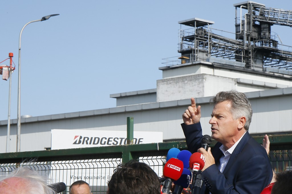 Communist party parliament member Fabien Roussel addresses Bridgestone employees outside the tire factory of Bethune, northern France, Thursday, Sept....