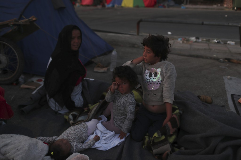 Children wake up as migrants remained camped out on a road leading from Moria to the capital of Mytilene, on the northeastern island of Lesbos, Greece...
