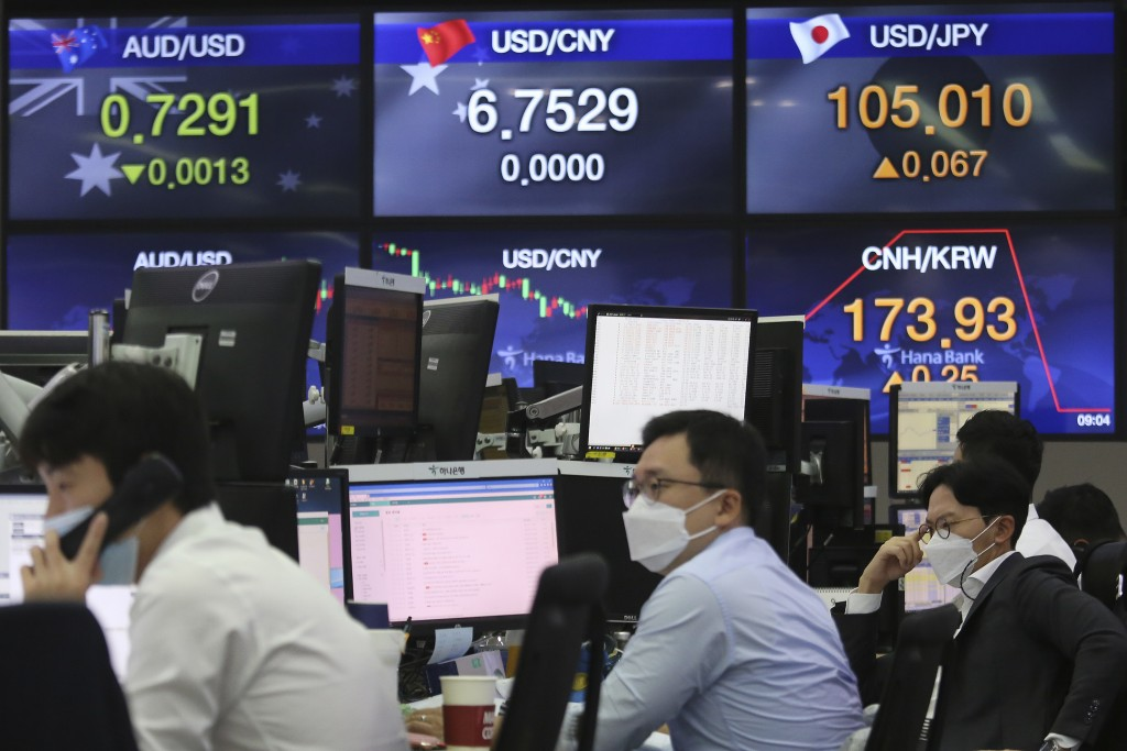 Currency traders work at the foreign exchange dealing room of the KEB Hana Bank headquarters in Seoul, South Korea, Thursday, Sept. 17, 2020. Asian st...