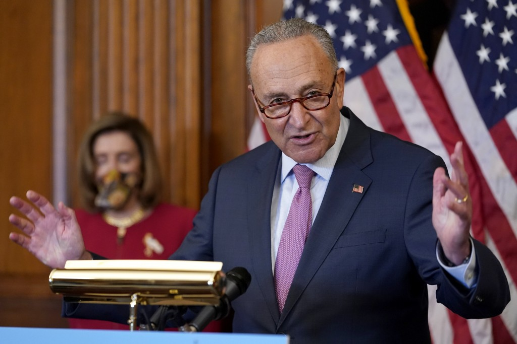 Senate Minority Leader Sen. Chuck Schumer of N.Y., right, speaks next to House Speaker Nancy Pelosi of Calif., during a news conference about COVID-19...