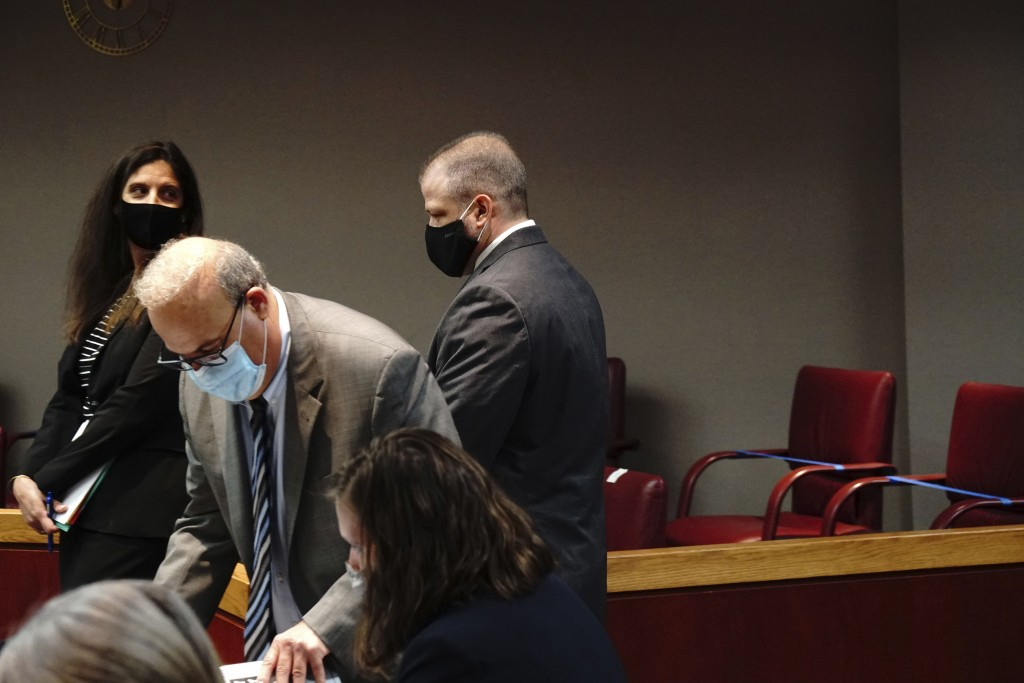 Andrew Polovin, right, a former supervisor with the Illinois Department of Children and Family Services, walks to the podium in the courtroom of Judge...