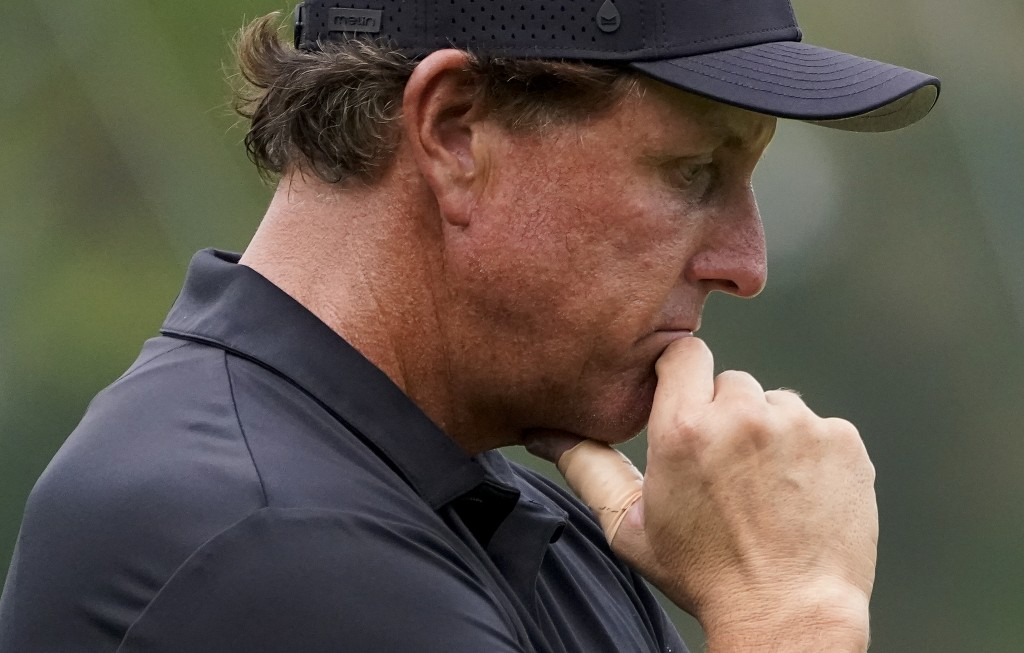 Phil Mickelson, of the United States, waits to putt on the 15th green during the first round of the US Open Golf Championship, Thursday, Sept. 17, 202...