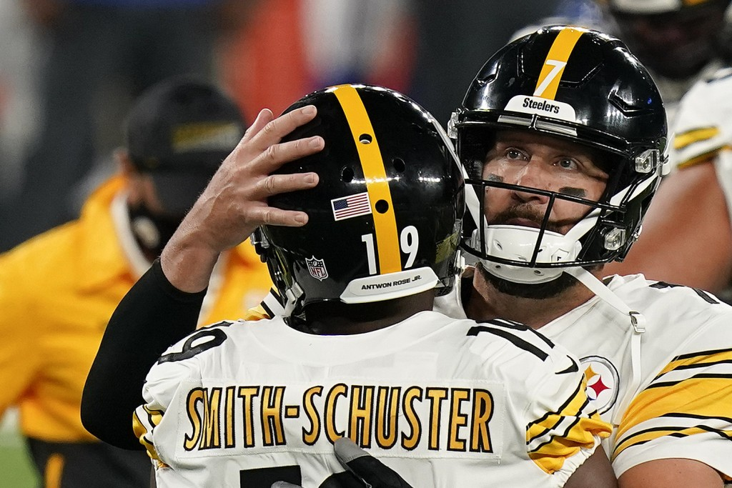 FILE - Pittsburgh Steelers wide receiver JuJu Smith-Schuster (19) celebrates with Pittsburgh Steelers quarterback Ben Roethlisberger (7) after scoring...