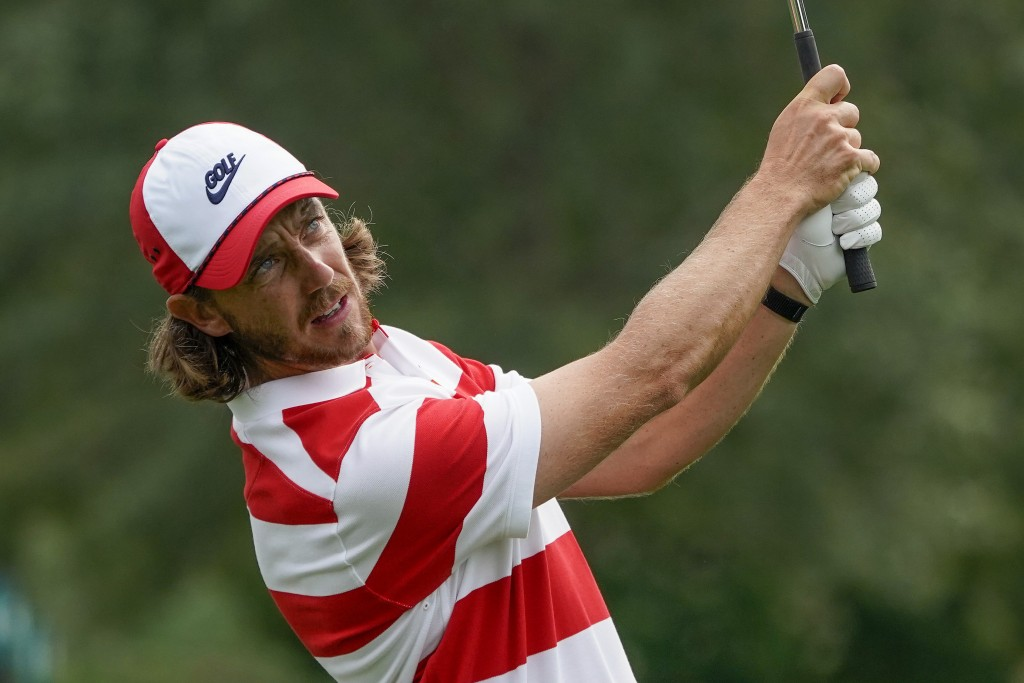 Tommy Fleetwood, of England, plays a shot out of the rough onto the 14th green during the first round of the US Open Golf Championship, Thursday, Sept...