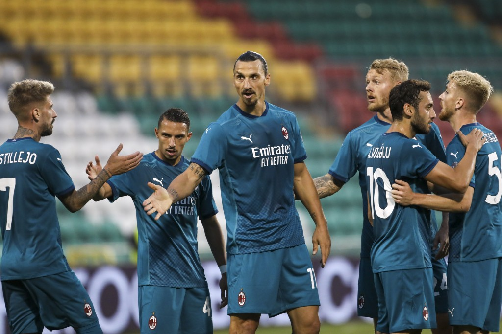 AC Milan's Zlatan Ibrahimovic, center, celebrates with his teammates after he scored his side's first goal during an Europa League second qualifying r...