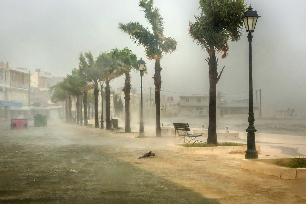 Seawater from crashing waves cover a road at the port of Argostoli, on the Ionian island of Kefalonia, western Greece, Friday, Sept. 18, 2020. Hurrica...