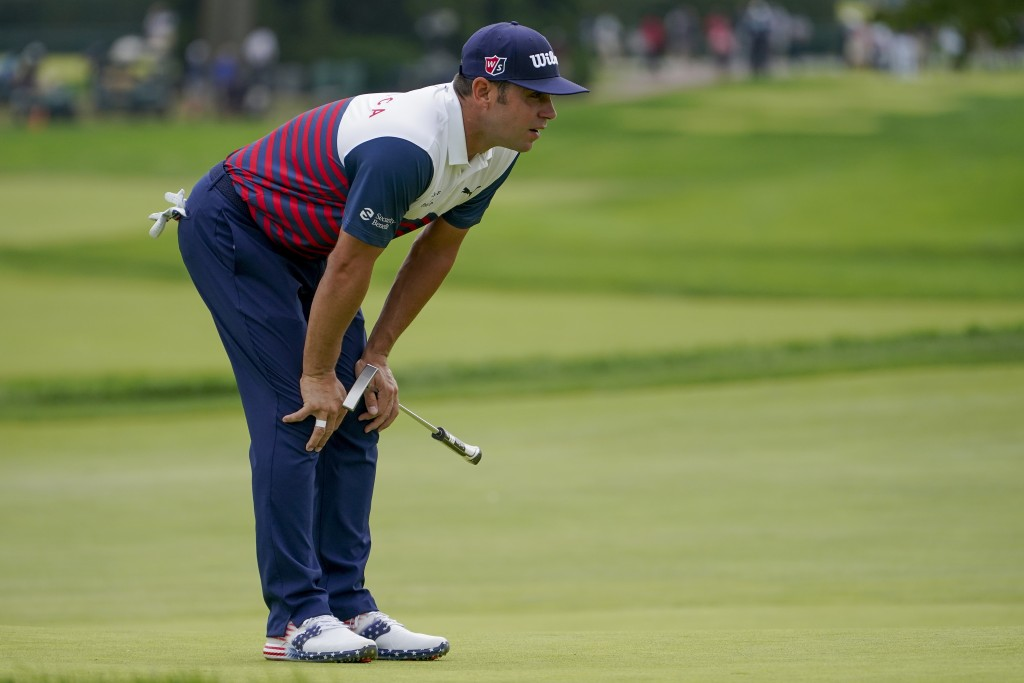 Gary Woodland, of the United States, lines up a putt on the first green during the first round of the US Open Golf Championship, Thursday, Sept. 17, 2...