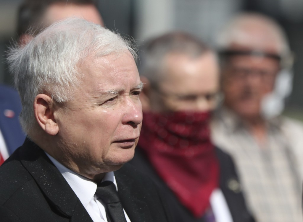 FILE - In this July 10, 2020 file photo, Poland's ruling party leader Jaroslaw Kaczynski, left, attends a police-guarded ceremony in Warsaw, Poland. A...