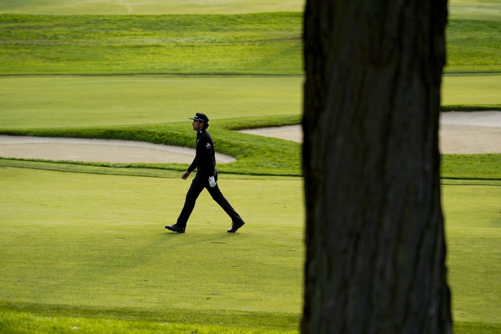 Rafael Cabrera Bello, of Spain, walks up the 12th fairway during the second round of the US Open Golf Championship, Friday, Sept. 18, 2020, in Mamaron...