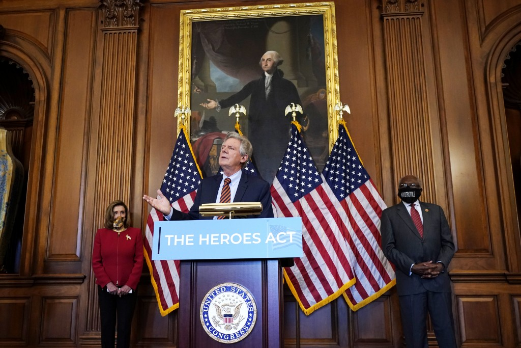 Chairman of the House Energy and Commerce Committee Rep. Frank Pallone, D-N.J., center, speaks next to House Speaker Nancy Pelosi of Calif., left, and...
