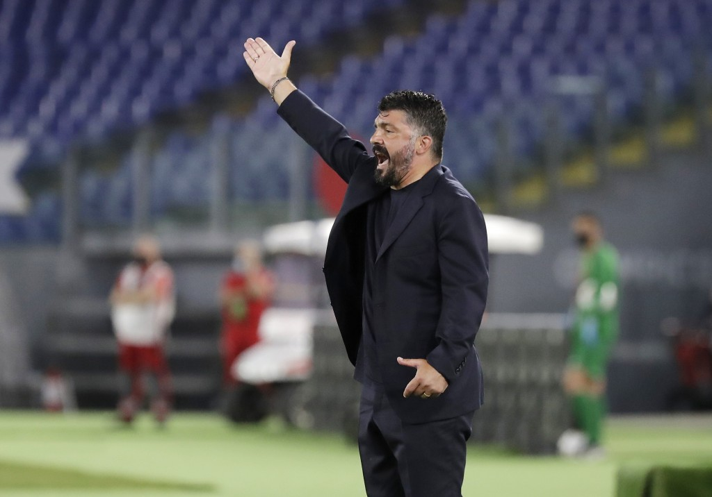 FILE - In this June 17, 2020 file photo, Napoli's head coach Gennaro Gattuso gives instructions during the Italian Cup soccer final match between Napo...