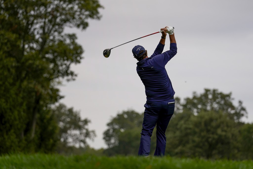 Phil Mickelson, of the United States, plays his shot from the 14th tee during the second round of the US Open Golf Championship, Friday, Sept. 18, 202...