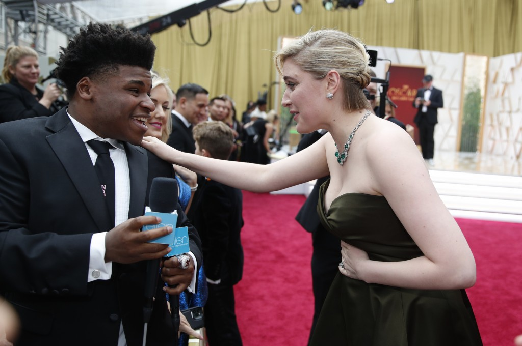 FILE - In this Feb. 9, 2020 file photo, Greta Gerwig, right, talks to Jerry Harris on the red carpet at the Oscars at the Dolby Theatre in Los Angeles...