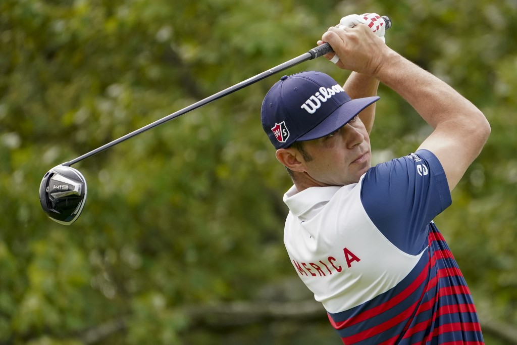 Gary Woodland, of the United States, plays his shot from the second tee during the first round of the US Open Golf Championship, Thursday, Sept. 17, 2...