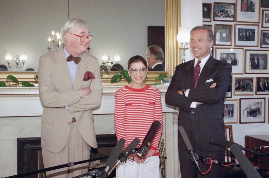 FILE - In this June 15, 1993, file photo, Judge Ruth Bader Ginsburg poses with Sen. Daniel Patrick Moynihan, D-N.Y., left, and Sen. Joseph Biden, D-De...