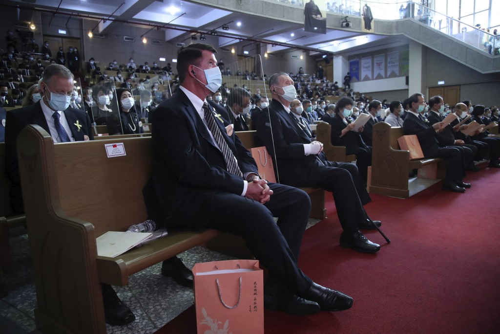U.S. Undersecretary of State Keith Krach, center and former Japanese Prime Minister Yoshiro Mori at right attend a memorial service for the late forme...