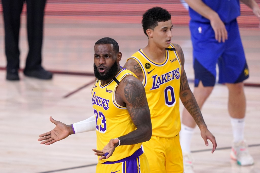 Los Angeles Lakers' LeBron James (23) gestures after an officials call as Kyle Kuzma (0) walks behind in the first half an NBA conference final playof...