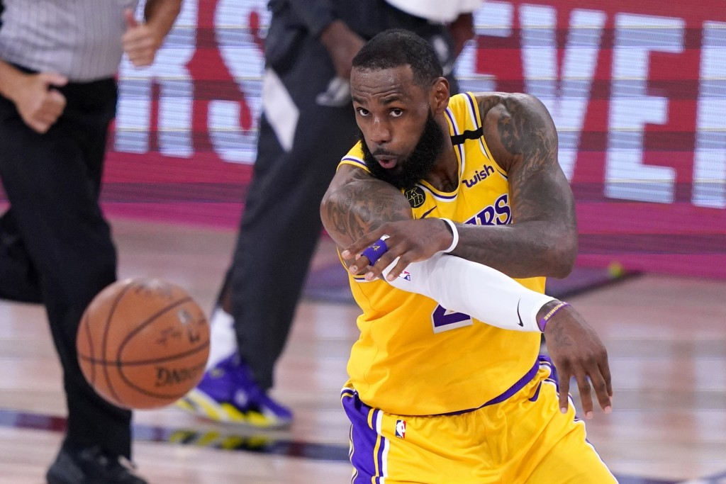 Los Angeles Lakers forward LeBron Jame makes a pass during the second half an NBA conference final playoff basketball game against the Denver Nuggets ...