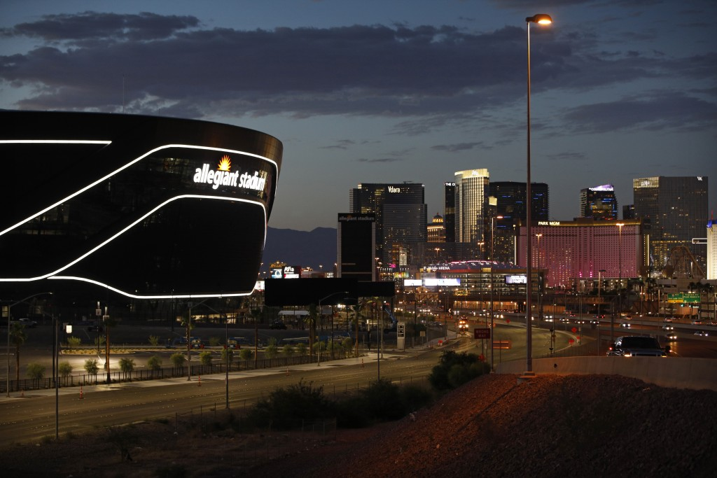 CORRECTS TO $2 BILLION, NOT 1.9 BILLION AS ORIGINALLY SENT - FILE - In this July 22, 2020, file photo, the sun sets behind Allegiant Stadium, home of ...