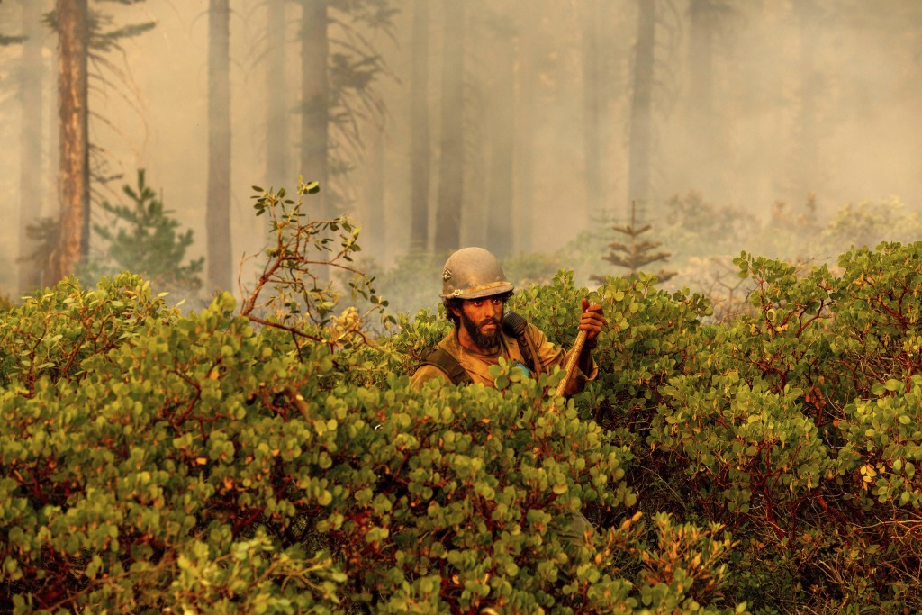 Firefighter Cody Carter battles the North Complex Fire in Plumas National Forest, Calif., on Monday, Sept. 14, 2020.   Firefighters trying to contain ...