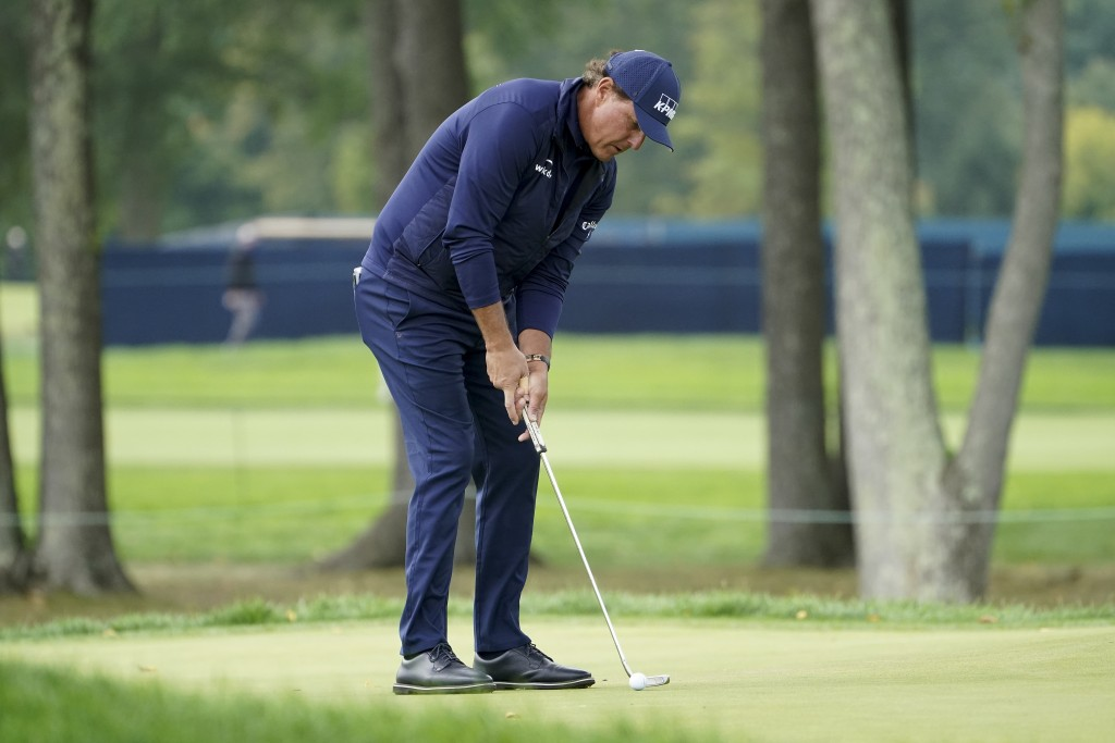 Phil Mickelson, of the United States, putts on the second green during the second round of the US Open Golf Championship, Friday, Sept. 18, 2020, in M...