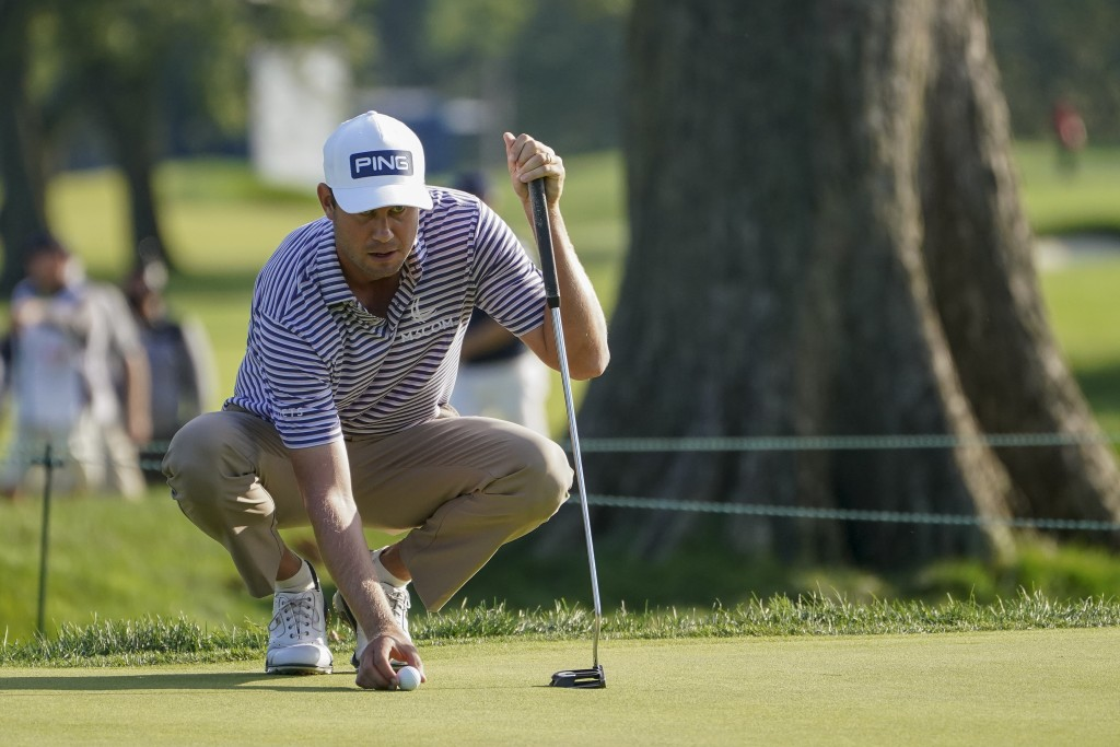 Harris English, of the United States, lines up a shot on on the fifth green during the second round of the US Open Golf Championship, Friday, Sept. 18...