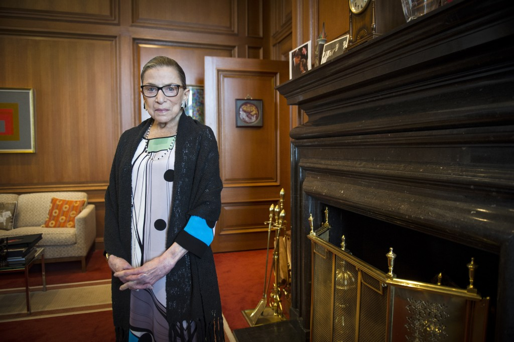 FILE - In this July 31, 2014, file photo, Associate Justice Ruth Bader Ginsburg is seen in her chambers in at the Supreme Court in Washington. The Sup...