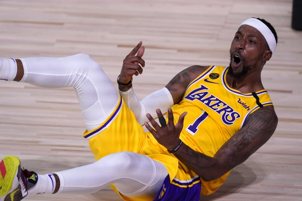 Los Angeles Lakers' Kentavious Caldwell-Pope (1) calls for a foul against the Denver Nuggets after scoring a basket during the second half an NBA conf...