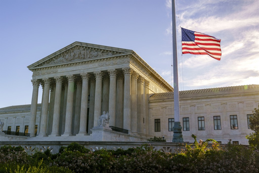 The flag flies at half-staff at the Supreme Court on the morning after the death of Justice Ruth Bader Ginsburg, 87, Saturday, Sept. 19, 2020 in Washi...