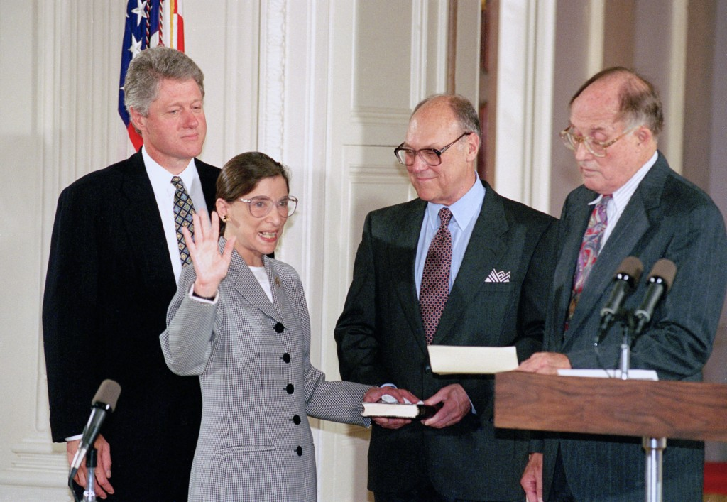 FILE - In this Aug. 10, 1993, file photo, Supreme Court Justice Ruth Bader Ginsburg takes the court oath from Chief Justice William Rehnquist, right, ...