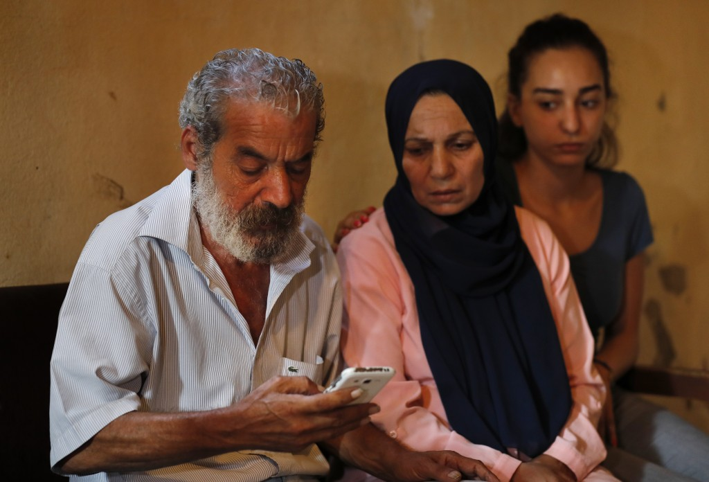 Khaldoun Mohammed, 58, left, the father of Mohammed, 27, who is still missing at sea while he was trying with other migrants to reach Cyprus on a boat...