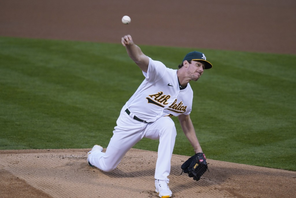 Oakland Athletics starting pitcher Chris Bassitt works in the first inning of a baseball game against the San Francisco Giants, Friday, Sept. 18, 2020...