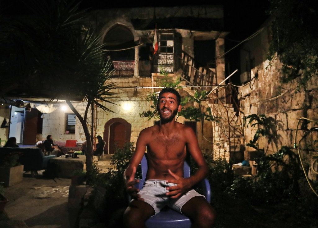 Ibrahim Lasheen, 22, who was brought back to his hometown after a U.N. naval force rescued him after he swam for 18 hours while he was migrating on a ...