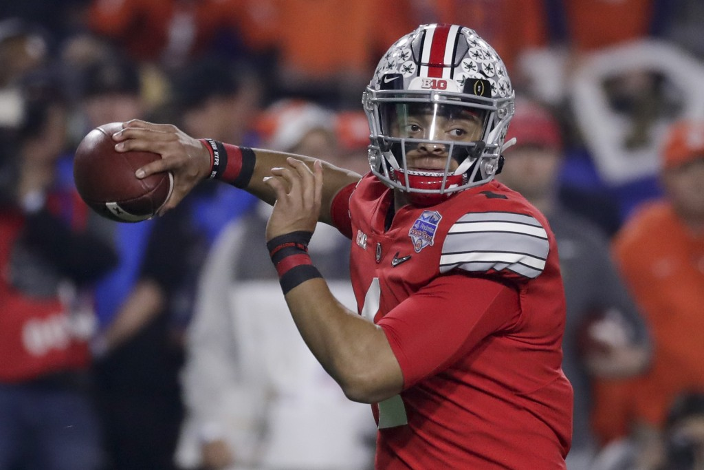FILE - In this Dec. 28, 2019, file photo, Ohio State quarterback Justin Fields throws a pass against Clemson during the first half of the Fiesta Bowl ...