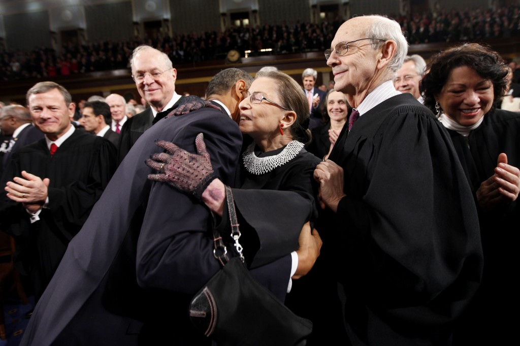 FILE - In this Jan. 25, 2011, file photo, President Barack Obama hugs Supreme Court Justice Ruth Bader Ginsburg on Capitol Hill in Washington, prior t...