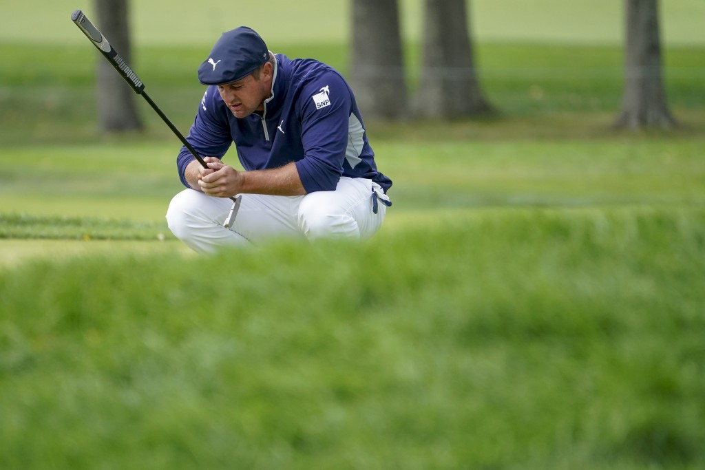 Bryson DeChambeau, of the United States, lines up a putt on the second green during the second round of the US Open Golf Championship, Friday, Sept. 1...