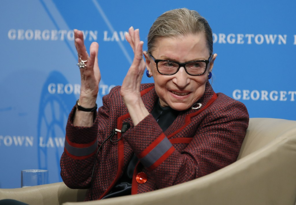 FILE - In this April 6, 2018, file photo, Supreme Court Justice Ruth Bader Ginsburg applauds after a performance in her honor after she spoke about he...