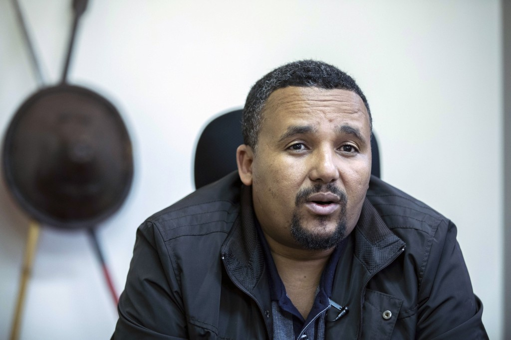 FILE - In this Thursday Oct. 24, 2019 file photo, Jawar Mohammed speaks during an interview with The Associated Press at his house in Addis Ababa, Eth...