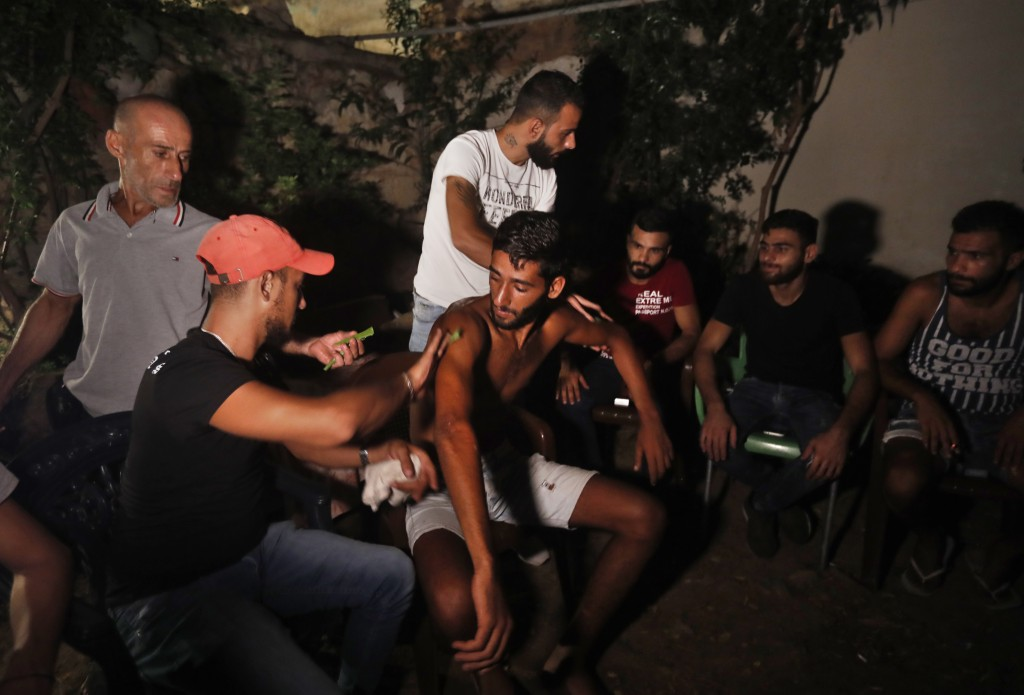 Lebanese Ibrahim Lasheen, 22, who was brought back to his hometown after a U.N. naval force rescued him after he swam for 18 hours while he was migrat...