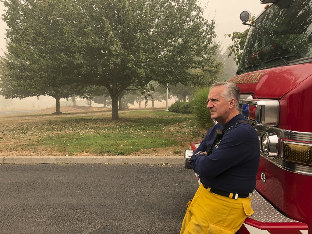 Oregon firefighter Steve McAdoo with Clackamas Fire talks on Sunday, Sept. 13, 2020, in Beavercreek, Ore., about spending long hours fighting wildfire...