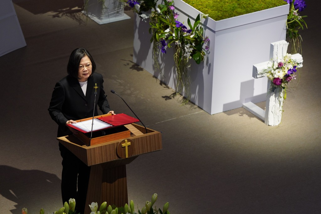Taiwan President Tsai Ing-wen attends a memorial service for the late former Taiwanese President Lee Teng-hui in Taipei, Taiwan on Saturday, Sept. 19,...